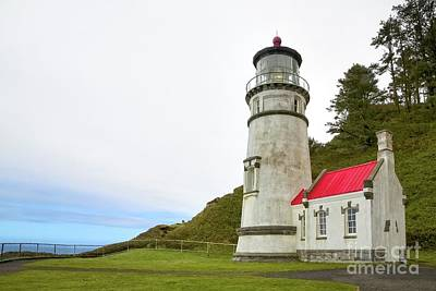 Photograph - The Lighthouse At Heceta Head by Jon Burch Photography