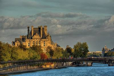 Photograph - The Louvre Beneath A Parisian Sunset  by Hany J