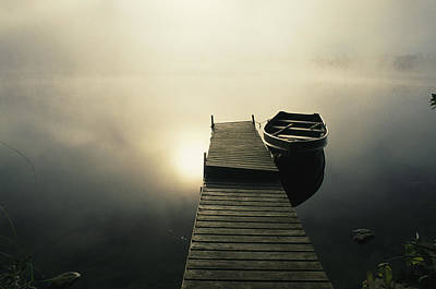 Docks Etc Photograph - The Morning Sun Shine On A Rowboat Tied by Stephen Alvarez