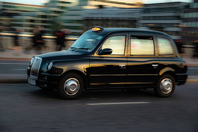 Fast Taxi Photograph - The Most Famous Cab In World by Marius Comanescu