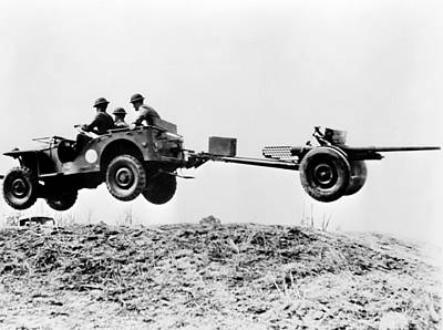The New Jeep In Mid-air As It Pulls Art Print by Everett