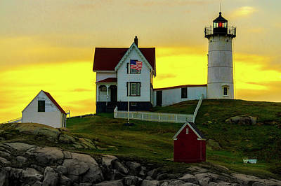 Photograph - The Nubble Cape Neddick Lighthouse In Maine At Dawn by Chris Lord