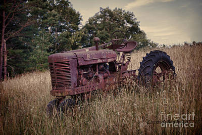 Photograph - The Old Farmall by Laurinda Bowling