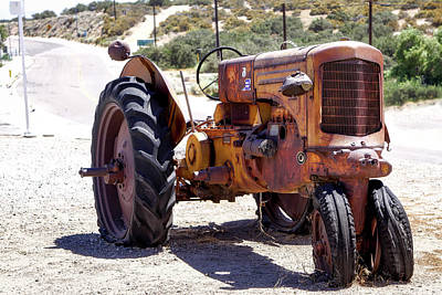 Photograph - The Old Yellow Farm Tractor by Gene Parks