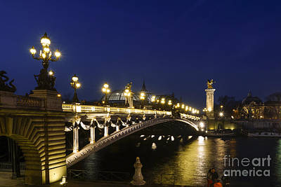 Photograph - The Pont Alexandre IIi, Arch Bridge In Paris At Night, Grand Palais Behind, France. by Perry Van Munster