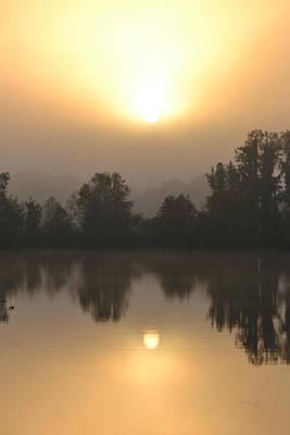 Photograph - The Rising Sun Over Alligator Lake by rd Erickson