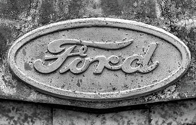 Photograph - The Rusty Ford Emblem Black And White by JC Findley