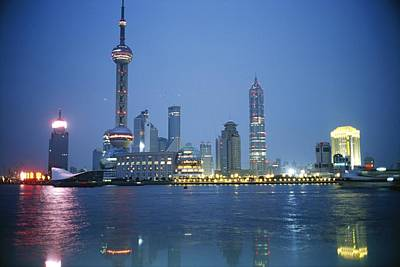 The Shanghai Skyline And Riverfront Art Print by Raul Touzon