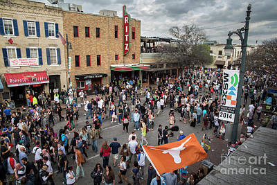 Photograph - The sights and sounds of SXSW are enormous from 6th Street as thousands of revelers fill the streets by Austin Welcome Center