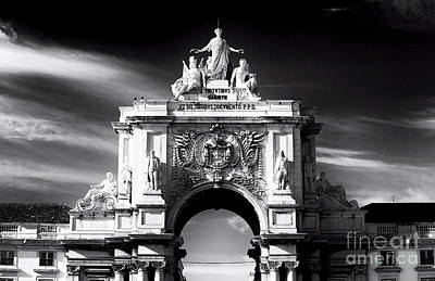 Black Commerce Photograph - The Statues Of Lisbon by John Rizzuto