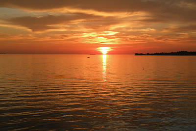 Photograph - The Sun Setting On Another Day At Cedar Key by rd Erickson