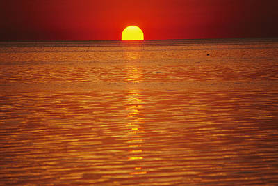 Natural Forces Photograph - The Sun Sinks Into Pamlico Sound Seen by Stephen St. John