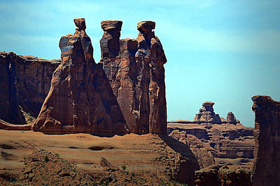 Photograph - The Three Gossips In Arches National Park by Nadalyn Larsen
