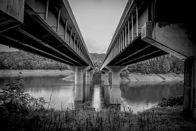 Photograph - The Underside Of Two Bridges Symmetry In Black And White by Kelly Hazel