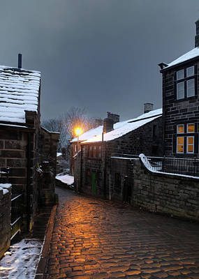 Photograph - The Village Of Heptonstall In The Snow At Night With Lamps Shini by Philip Openshaw