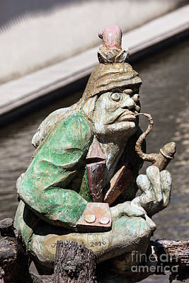 Photograph - The Water Goblin Statue Guarding Velkoprerovsky Mill On Certovka Or Devil's Stream. Prague, Czech Republic by Michal Bednarek