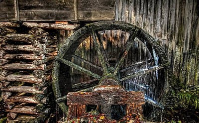 Photograph - The Wheel Goes Around by Dave Bosse