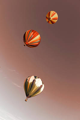 Three Balloons Swirling Skyward Art Print by Jeff Swan