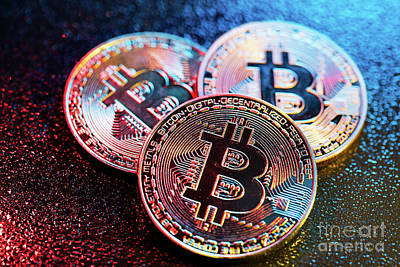Photograph - Three Bitcoin Coins In A Colorful Lighting. by Michal Bednarek
