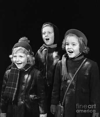 Snowy Night Photograph - Three Children Caroling, C.1940s by H. Armstrong Roberts/ClassicStock