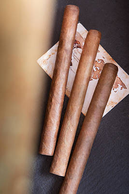 Photograph - Three Cigars  by Andrey  Godyaykin