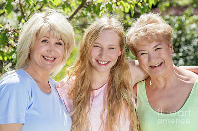 Hug Photograph - Three Generations Of Women. Family Spending Time Together In The Garden by Michal Bednarek