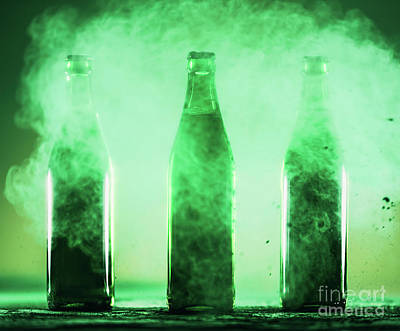 Beer Royalty-Free and Rights-Managed Images - Three green bottles standing in a green dust. by Michal Bednarek