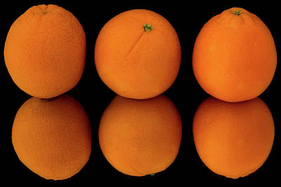 Photograph - Three Oranges With Reflection by Menachem Ganon