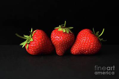 Photograph - Three Strawberries On Black H by Alan Harman