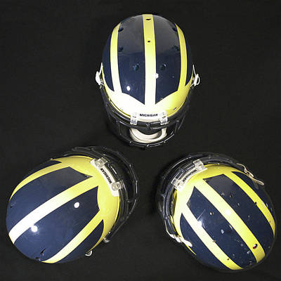 Photograph - Three Striped Wolverine Helmets by Michigan Helmet
