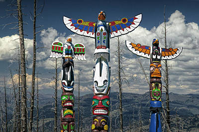 Three Totem Poles In The Northwest Print by Randall Nyhof