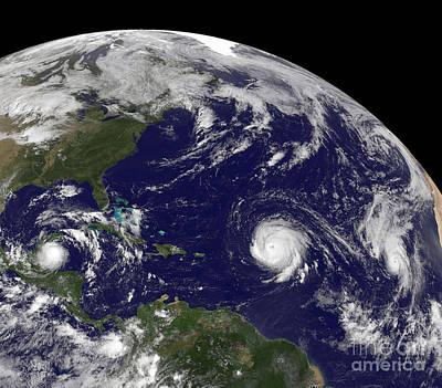 Three Tropical Cyclones Active Art Print by Stocktrek Images