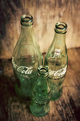 Photograph - Three Vintage Coca Cola Bottles  by Terry DeLuco