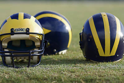 Photograph - Three Wolverine Helmets by Michigan Helmet