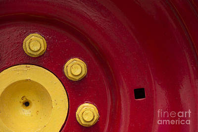 Photograph - Three Yellow Nuts On A Red Wheel by Wendy Wilton