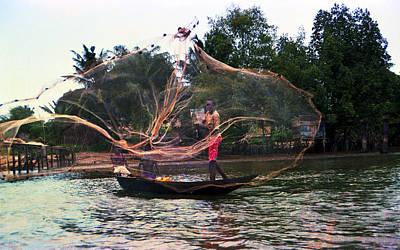 Photograph - Throwing Fishing Net by Muyiwa OSIFUYE