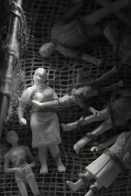 Impersonal Photograph - Tiny Family Figurines Tied To A Cloth by Ulrich Kunst And Bettina Scheidulin
