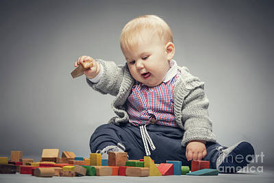 Photograph - Toddler Boy Playing With Building Blocks. by Michal Bednarek