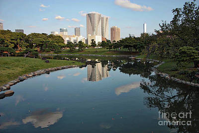 Reflection On Pond Photograph - Tokyo Buildings And Garden Pond by Carol Groenen