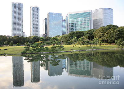 Reflection On Pond Photograph - Tokyo Skyline Reflection by Carol Groenen