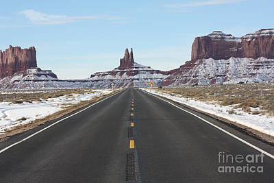 Photograph - Tombstone Alley In Monument Valley by Brian Boyle