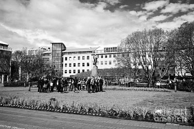 tourists on walking tour in austurvollur public square Reykjavik iceland Art Print