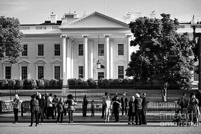 Whitehouse Wall Art - Photograph - tourists outside the north facade from pennsylvania avenue the white house Washington DC USA by Joe Fox