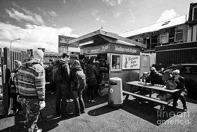 Hotdog Stands Photograph - tourists queue at bbp islendingar borda ss pylsur icelands best hot dog stand Reykjavik iceland by Joe Fox