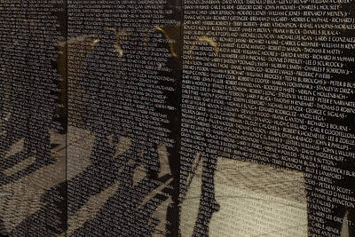 Vietnam Veterans Memorial Wall Photograph - Tourists Walking By Reflected by Todd Gipstein