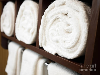 Brown Color Photograph - Towel Rack With Rolled Towels by Paul Velgos
