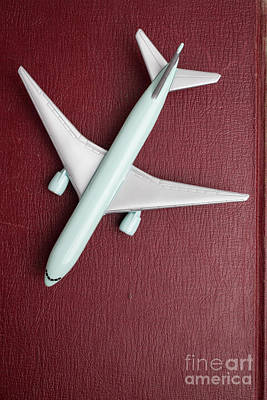 Toy Planes Photograph - Toy Airplane Over Red Book Cover by Edward Fielding