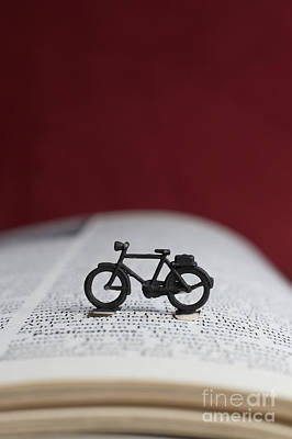 Photograph - Toy Bicycle On An Open Book by Edward Fielding