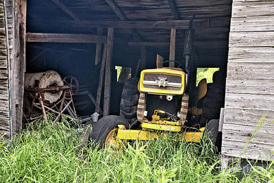 Nikki Vig Royalty-Free and Rights-Managed Images - Tractor and Equipment in Abandoned Barn by Nikki Vig