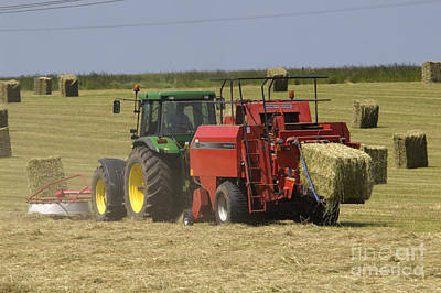Tractor Bailing Hay At Harvest Time Art Print